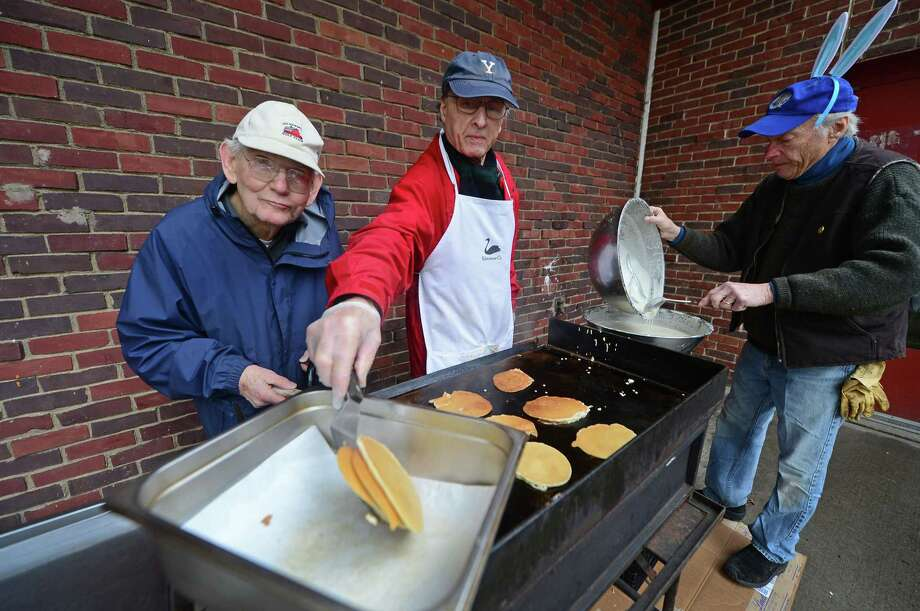 David Borglum, Michel Cornier and Robert Lachman prepare pancakes during the 28th annual Silvermine Community Association Pancake Breakfast Saturday, April 1, at Silvermine Elementary School in Norwalk. The Easter-themed breakfast was served in the cafeteria of the Silvermine School on Perry Avenue. Photo: Erik Trautmann / Hearst Connecticut Media / Norwalk Hour