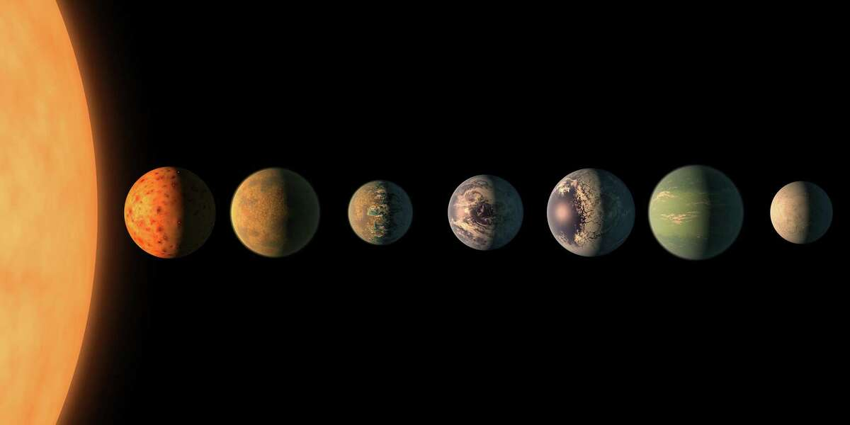 In this illustration, the Trappist-1 star - an ultracool dwarf - is orbited by seven Earth-size planets.