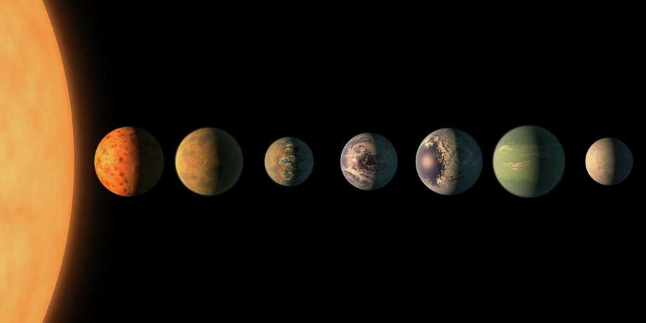 In this illustration, the Trappist-1 star - an ultracool dwarf - is orbited by seven Earth-size planets. Photo: NASA/JPL-Caltech, Handout / Handout