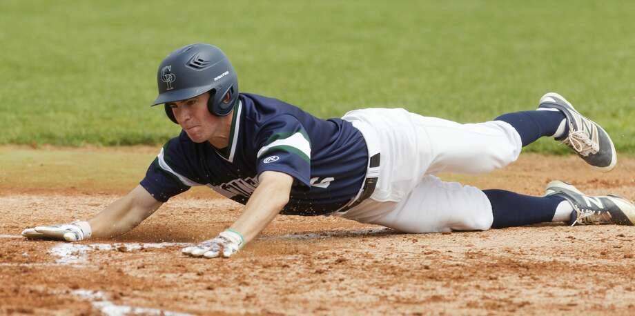 Luke Repka #6 of College Park slides in to score on a wild pitch by during the first inning of a non-district baseball game at Fr. Wilson Field on Saturday, April 1, 2017, in Houston. St. Thomas defeated College Park 10-5. Photo: Jason Fochtman/Houston Chronicle