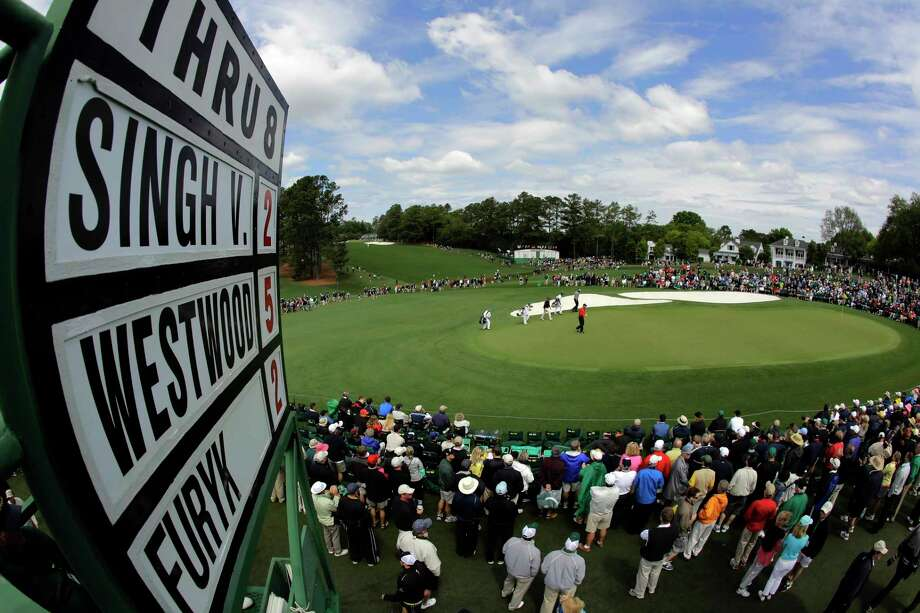 """FILE- In this April 6, 2012, file photo, Lee Westwood, of England, Vijay Singh, of Fiji, and Jim Furyk walk up to the ninth green during the second round the Masters golf tournament in Augusta, Ga. If the Masters doesn't really begin until the back nine Sunday, the final place to build, or lose, momentum is the 460-yard ninth hole known as """"Carolina Cherry."""" (AP Photo/Charlie Riedel, File) Photo: Charlie Riedel, STF / Copyright 2017 The Associated Press. All rights reserved."""