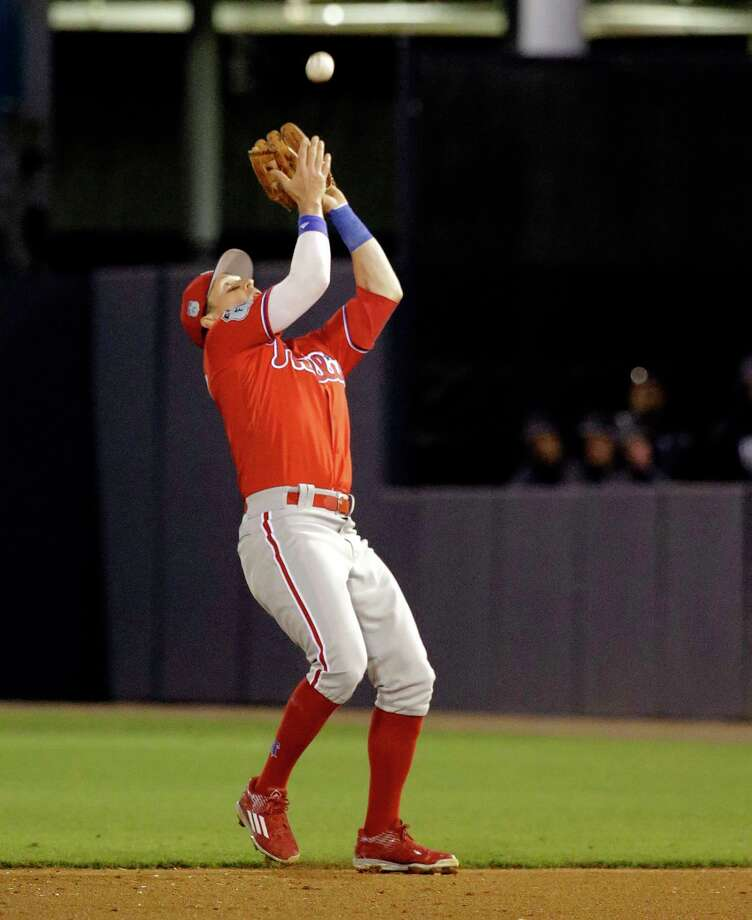 FILE - In this March 15, 2017, file photo, Philadelphia Phillies second baseman Chris Coghlan catches a pop fly in the fifth inning of a spring training baseball game in Tampa, Fla. Coghlan spent spring training with the Phillies using a wrist band to measure his sleep and recovery.(AP Photo/John Raoux) Photo: John Raoux, STF / Copyright 2017 The Associated Press. All rights reserved.