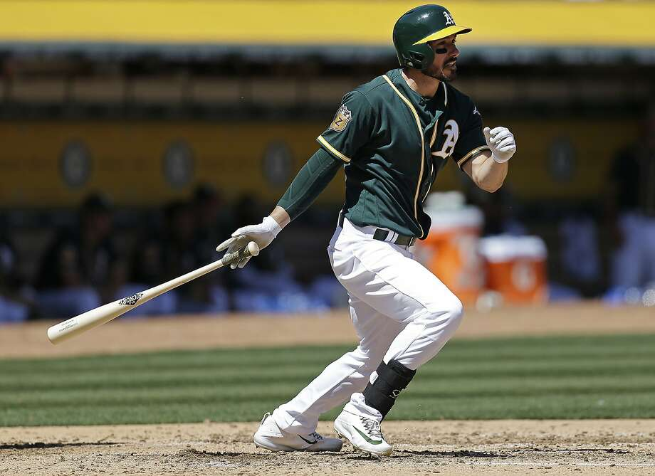 Oakland Athletics' Matt Joyce swings for a two-run double off San Francisco Giants' Tyler Beede in the third inning of an exhibition baseball game Saturday, April 1, 2017, in Oakland, Calif. (AP Photo/Ben Margot) Photo: Ben Margot, Associated Press