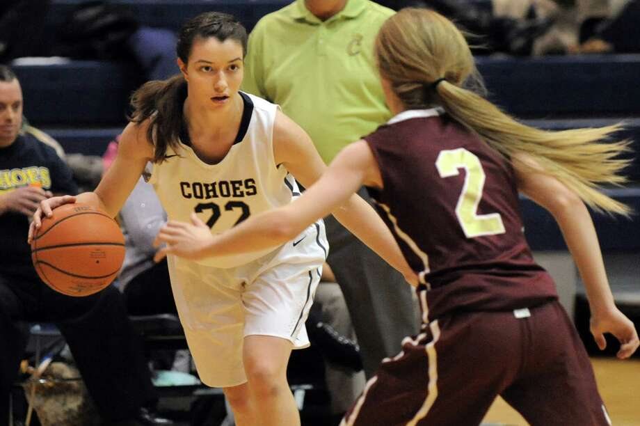 Cohoes' Nerea Brajac, left, controls the ball as Fonda's Julianna Taylor defends during their basketball game on Thursday Dec. 18, 2014, at Cohoes High in Cohoes, N.Y. (Cindy Schultz / Times Union) Photo: Cindy Schultz / 00029920A