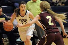 Cohoes' Nerea Brajac, left, controls the ball as Fonda's Julianna Taylor defends during their basketball game on Thursday Dec. 18, 2014, at Cohoes High in Cohoes, N.Y. (Cindy Schultz / Times Union)