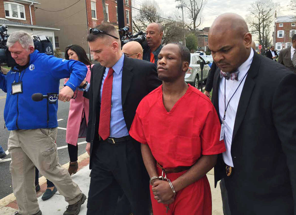 Dejohn Lee, accused of raping at least nine women, starting when he was 16, is escorted by police to an arraignment hearing in Media, Pa., on Thursday.
