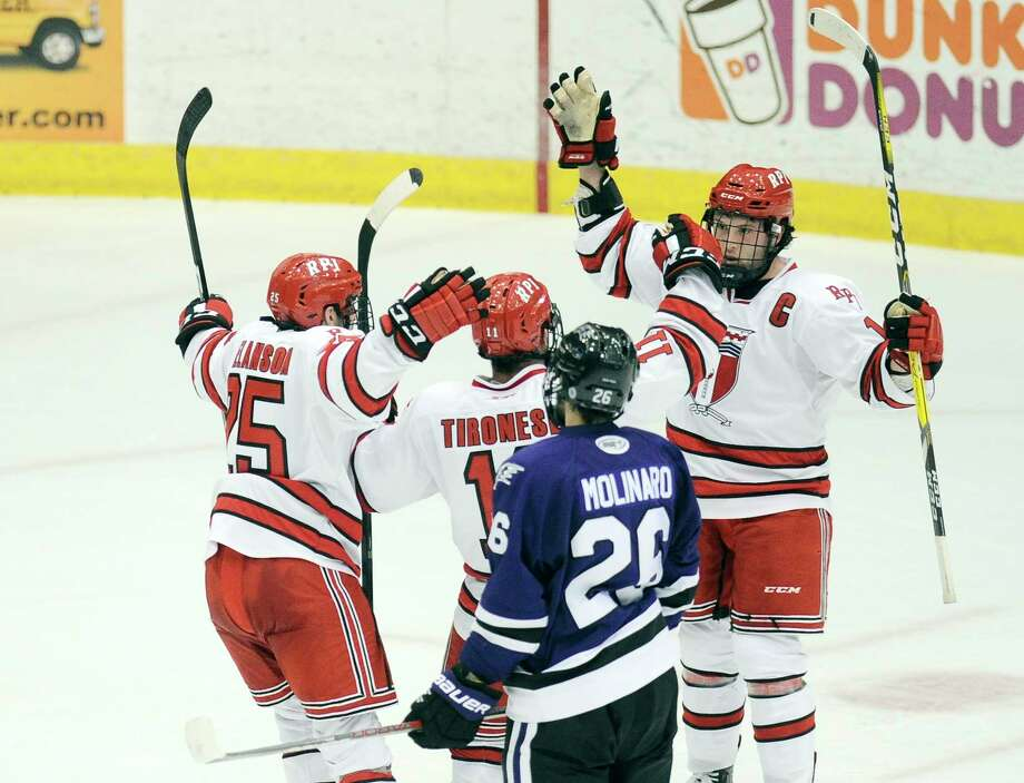 Rensselaer Polytechnic Institute players celebrate a Evan Tironese (11) goal against Niagara during the second period of an NCCA hockey game in Troy, N.Y., Friday, Oct. 21, 2016. (Hans Pennink / Special to the Times Union)      ORG XMIT: HP104 Photo: Hans Pennink / Hans Pennink
