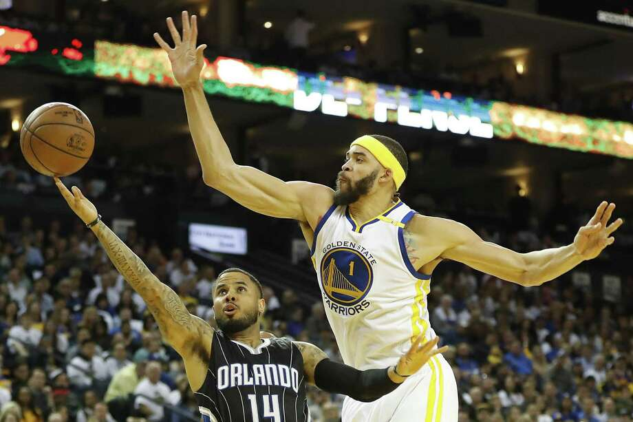 D.J. Augustin (14) of the Orlando Magic drives for a layup as JaVale McGee (1) of the Golden State Warriors defends during the third quarter of their NBA basketball game at Oracle Arena in Oakland, Calif. on Thursday, March 16, 2017. The Warriors defeated the Magic 122-92. Photo: Stephen Lam / Special To The Chronicle / ONLINE_YES
