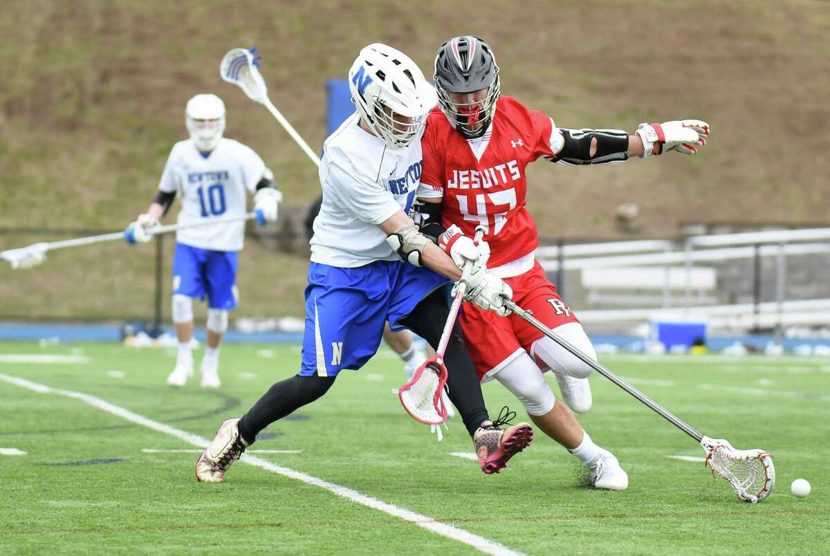 Game action between the Fairfield Prep Jesuits and the Newtown Night Hawks at Newtown High School on April 1, 2017 in Newtown, Connecticut.
