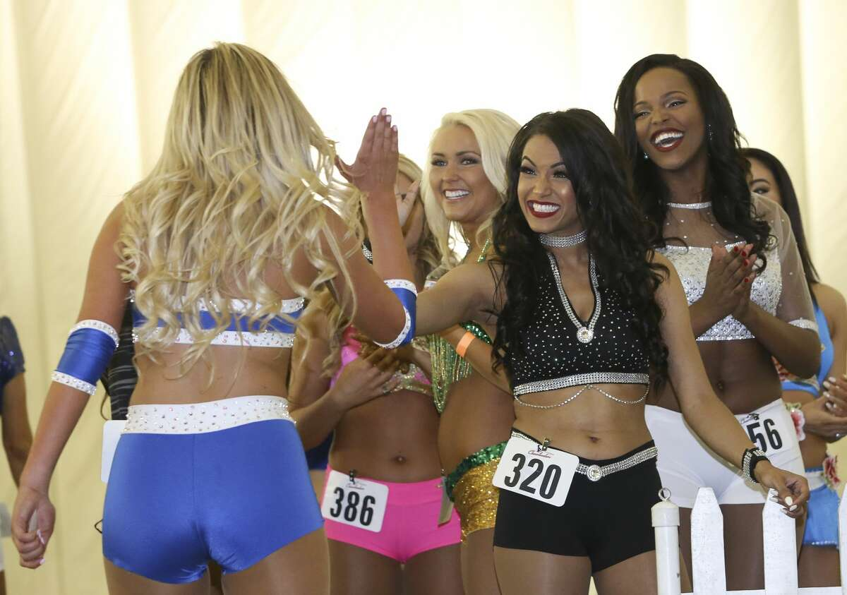 Houston Texans Cheerleading Tryouts participants high-five with each other after tryout at Methodist Training Center Saturday, April 1, 2017, in Houston. ( Yi-Chin Lee / Houston Chronicle )