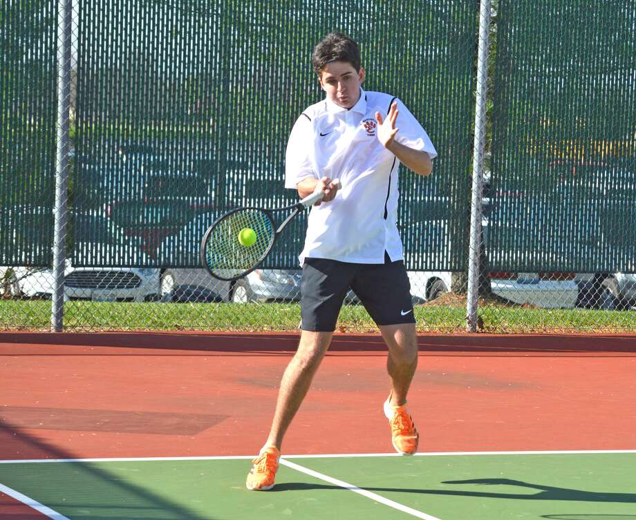 Edwardsville's Logan Kuhns makes a forehand return during his No. 3 doubles match against Louisville (Ky.) St. Xavier on Saturday at the Tiger Invitational at EHS.