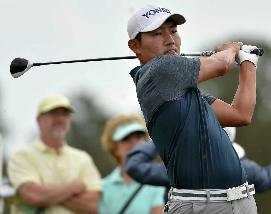 Sung Kang watches his tee shot on the third hole during the third round of the Houston Open golf tournament, Saturday, April 1, 2017, in Humble, Texas. Photo: Eric Christian Smith, FRE / FR171023 AP