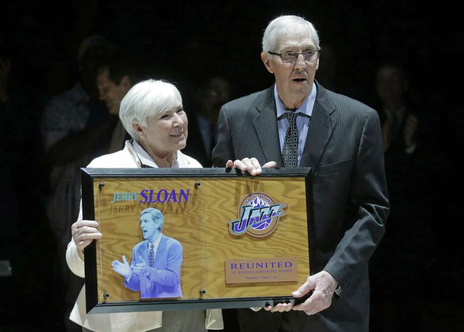 Utah Jazz owner Gail Miller and former coach Jerry Sloan pose for a photograph during a 20-year reunion ceremony for the basketball team that reached the 1997 NBA Finals, at halftime of the Jazz's game against the New York Knicks on Wednesday, March 22, 2017, in Salt Lake City. (AP Photo/Rick Bowmer, Pool) Photo: Rick Bowmer, STF / Associated Press / Copyright 2017 The Associated Press. All rights reserved.