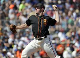 San Francisco Giants relief pitcher Ty Blach throw against the San Diego Padres during the third inning of a spring training baseball game, Tuesday, March 21, 2017, in Scottsdale, Ariz. (AP Photo/Matt York)