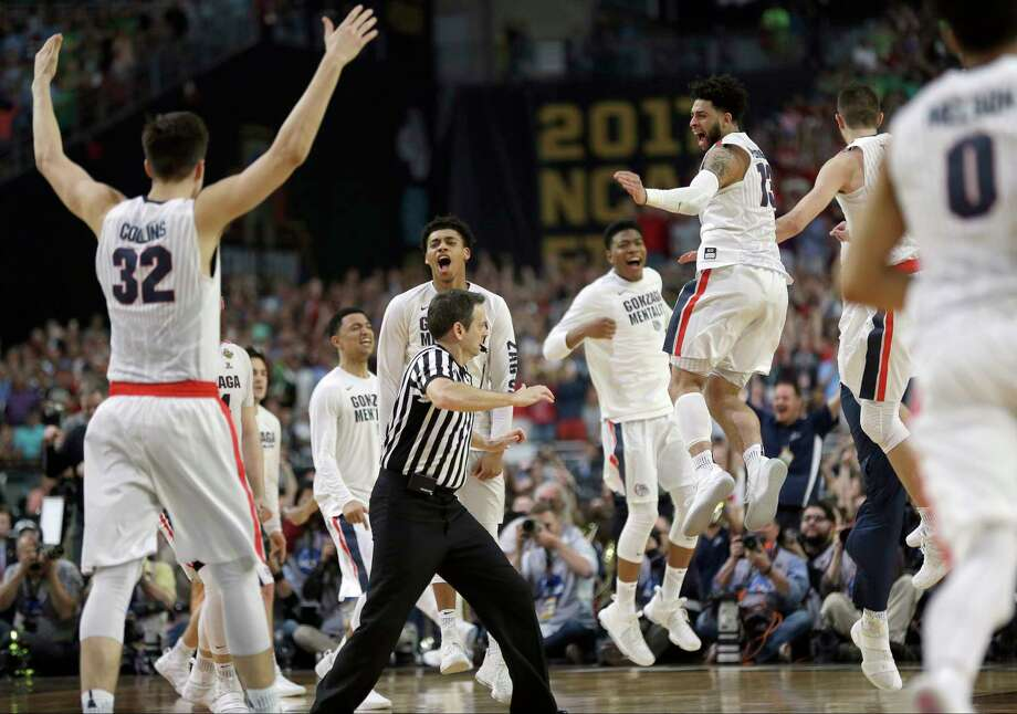 Gonzaga players celebrate after the semifinals of the Final Four NCAA college basketball tournament against South Carolina, Saturday in Glendale, Ariz. Gonzaga won 77-73. Photo: David J. Phillip, STF / Copyright 2017 The Associated Press. All rights reserved.