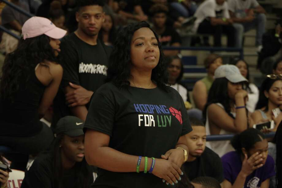 "Stacey Riddle, mother of Brianna and Jade Robinson, the Bellaire students who died in a spring break distracted-driving accident last year, prepares to address the crowd gathered in Butler Field House, Saturday, March 25 at the second annual ""Hooping for Luv"" event. The two exhibition games and dunk contest featured some of the top, college-bound basketball talent in the city and nearby areas. Photo: Bruce Bell Media"
