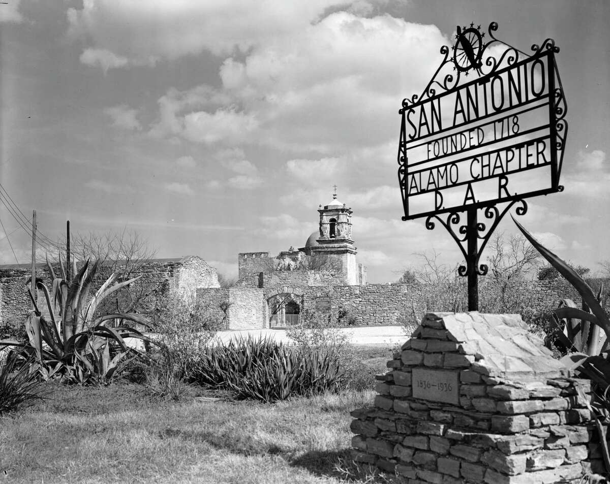 The sign at the west gate of Mission San Jose notes the founding of San Antonio in 1718 and the Alamo Chapter of the Daughters of the American Revolution or D.A.R. The photo was taken in 1939.