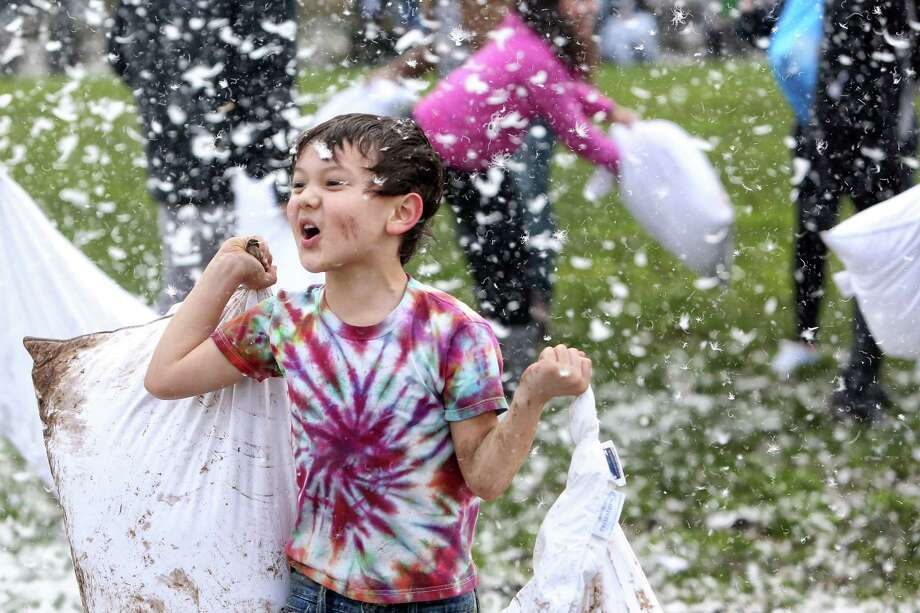 Six-year-old Colton Estey lets out a battle cry during the annual International Pillow Fight Day event Saturday, April 1, 2017, at Cal Anderson Park in Seattle. Photo: GENNA MARTIN, SEATTLEPI.COM / SEATTLEPI.COM