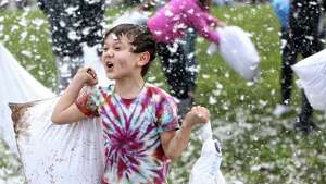 Six-year-old Colton Estey lets out a battle cry during the annual International Pillow Fight Day event Saturday, April 1, 2017, at Cal Anderson Park in Seattle.