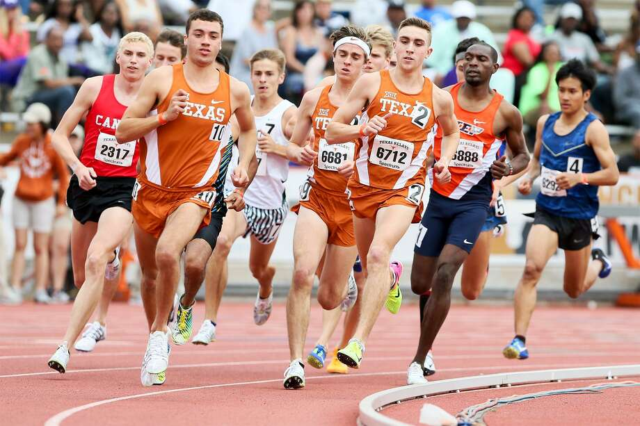 New Braunfels Canyon's Sam Worley (left) runs outside the pack led by UT's Alex Rogers (2), a former teammate, on the first turn of the Jerry Thompson Invitational Mile Run during the 2017 Texas Relays at Mike A. Myers Stadium in Austin on Saturday, April 1, 2017.  MARVIN PFEIFFER/ mpfeiffer@express-news.net Photo: Marvin Pfeiffer, Staff / San Antonio Express-News / Express-News 2017