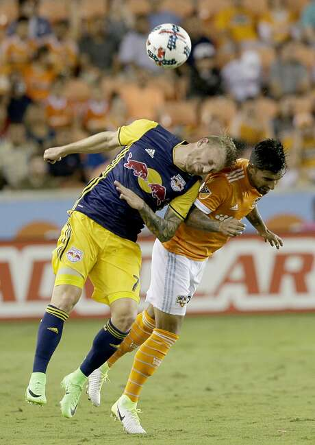 New York Red Bulls midfielder Derrick Etienne (7) and Houston Dynamo defender A. J. DeLaGarza (20) fight for a header in the first half on April 1, 2017 at BBVA Stadium in Houston, TX. (Photo: Thomas B. Shea/For the Chronicle) Photo: Thomas B. Shea/For The Chronicle