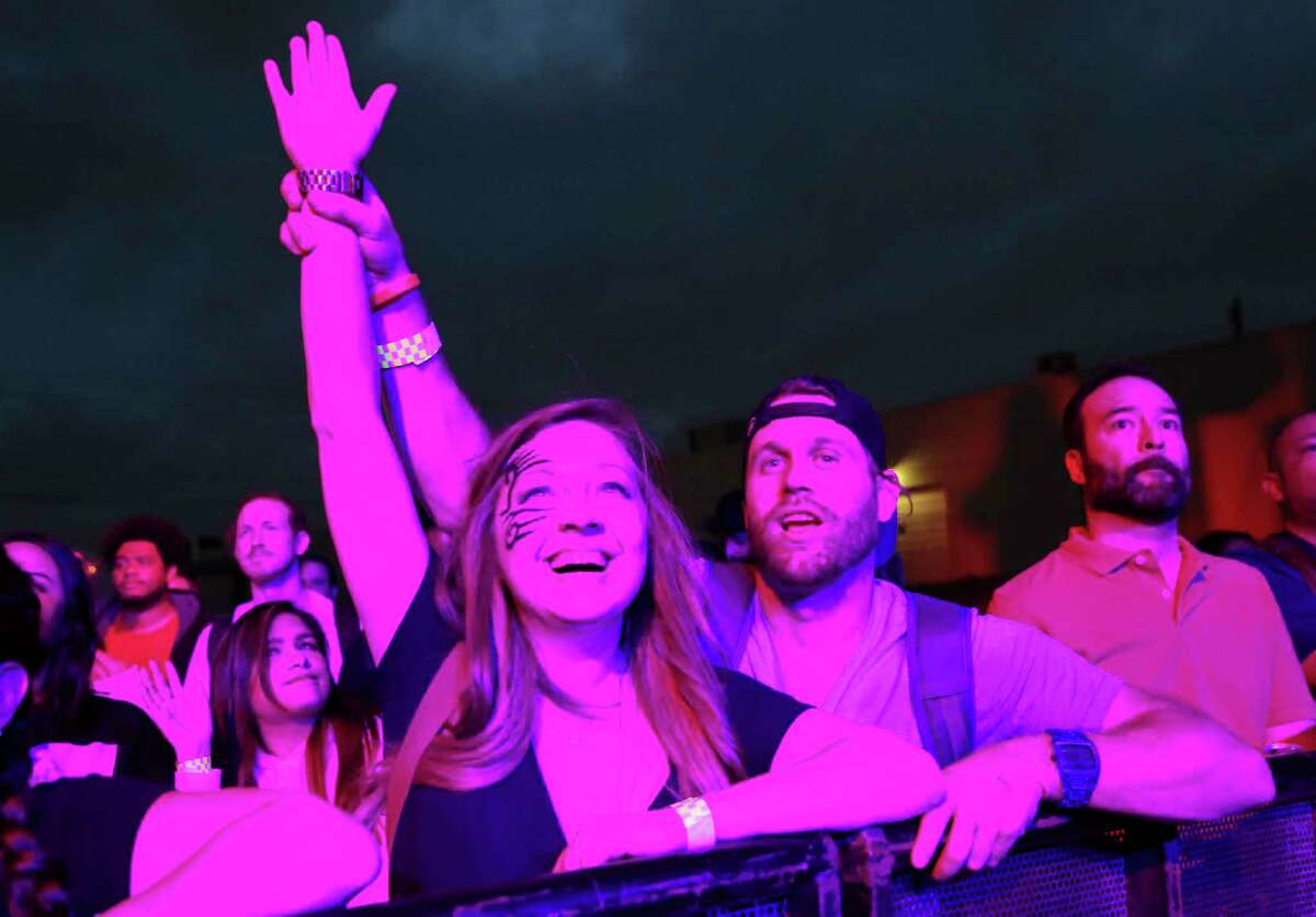 Revelers watch Ghostface Killah, one of the original members of the Wu-Tang Clan, perform Saturday at the Houston Whatever Fest. The festival - a celebration of comedy, music and art - concludes Sunday.