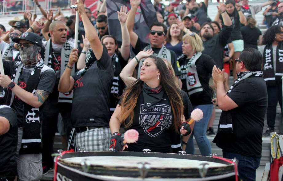 Amanda Rodriguez plays a drum as other Mission City Firm members cheer before the San Antonio FC soccer match on April 1, 2017 at Toyota Field. Photo: Edward A. Ornelas /San Antonio Express-News / © 2017 San Antonio Express-News