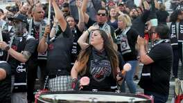 Amanda Rodriguez plays a drum as other Mission City Firm members cheer before the San Antonio FC soccer match on April 1, 2017 at Toyota Field.