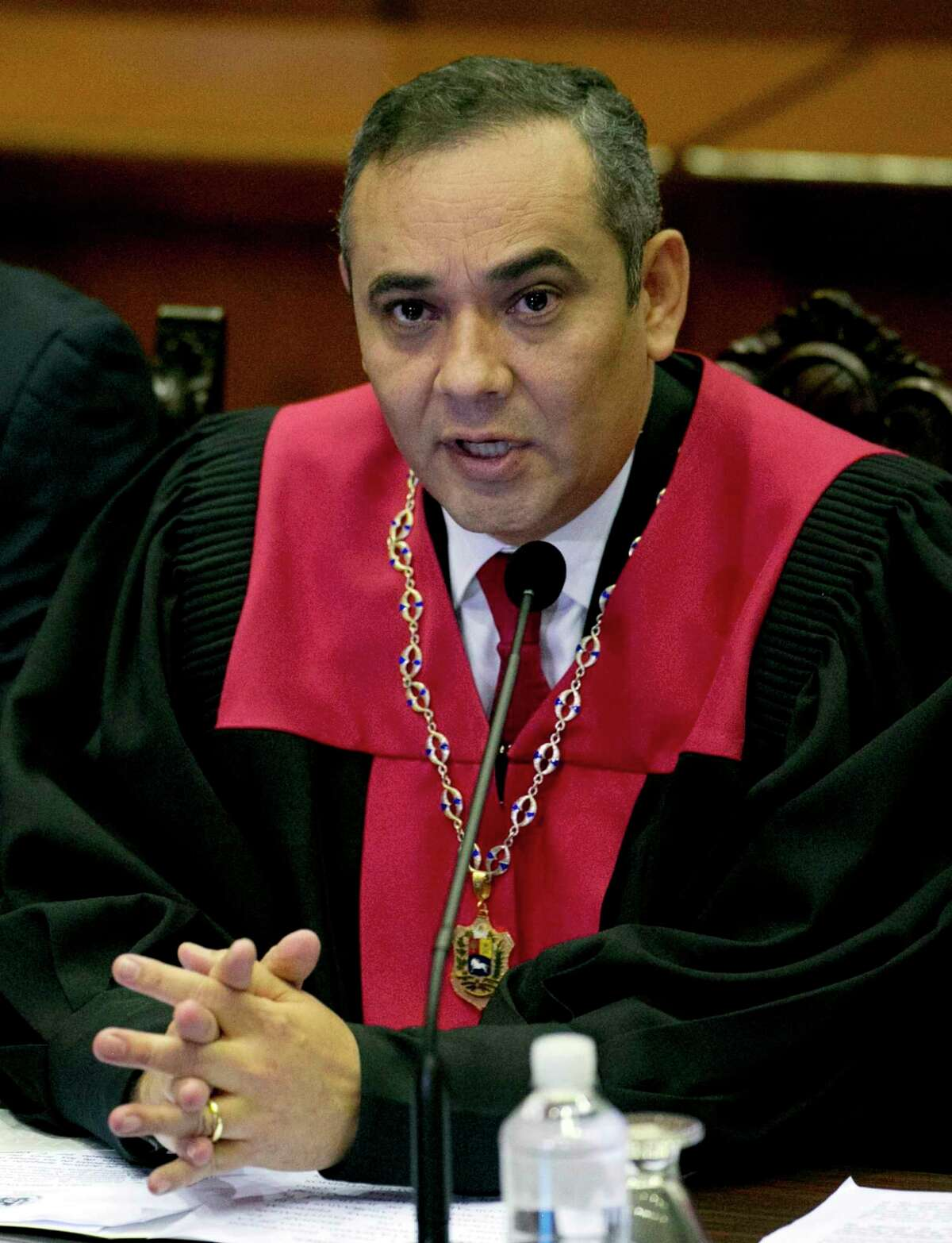 Venezuela's Supreme Court President Maikel Moreno speaks during a meeting with Ambassadors from different countries and Diplomatics at the Supreme Court in Caracas, Venezuela, Saturday, April 1, 2017. Venezuela's president and Supreme Court backed down Saturday from an audacious move to strip congress of its legislative powers that had sparked widespread charges that the South American country was no longer a democracy. (AP Photo/Ariana Cubillos)