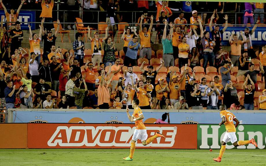 The Dynamo's Erick Torres acknowledges an adoring audience after scoring his final goal in added time Saturday night to complete a hat trick in a 4-1 win over the New York Red Bulls at BBVA Compass Stadium. Photo: Thomas B. Shea, Freelance / © 2017Thomas B. Shea