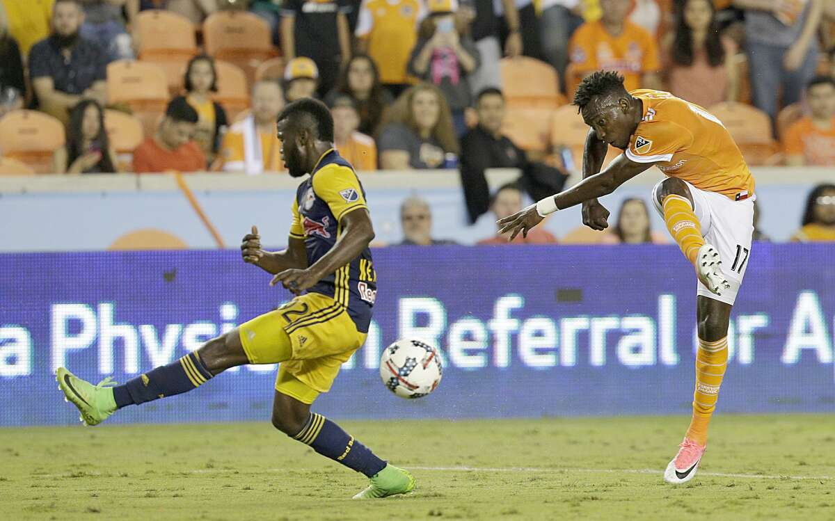 Houston Dynamo forward Alberth Elis (17) shoots while New York Red Bulls defender Kemar Lawrence (92). Tries to block the shot in the second half on April 1, 2017 at BBVA Stadium in Houston, TX. Dynamo won 4 to 1.(Photo: Thomas B. Shea/For the Chronicle)