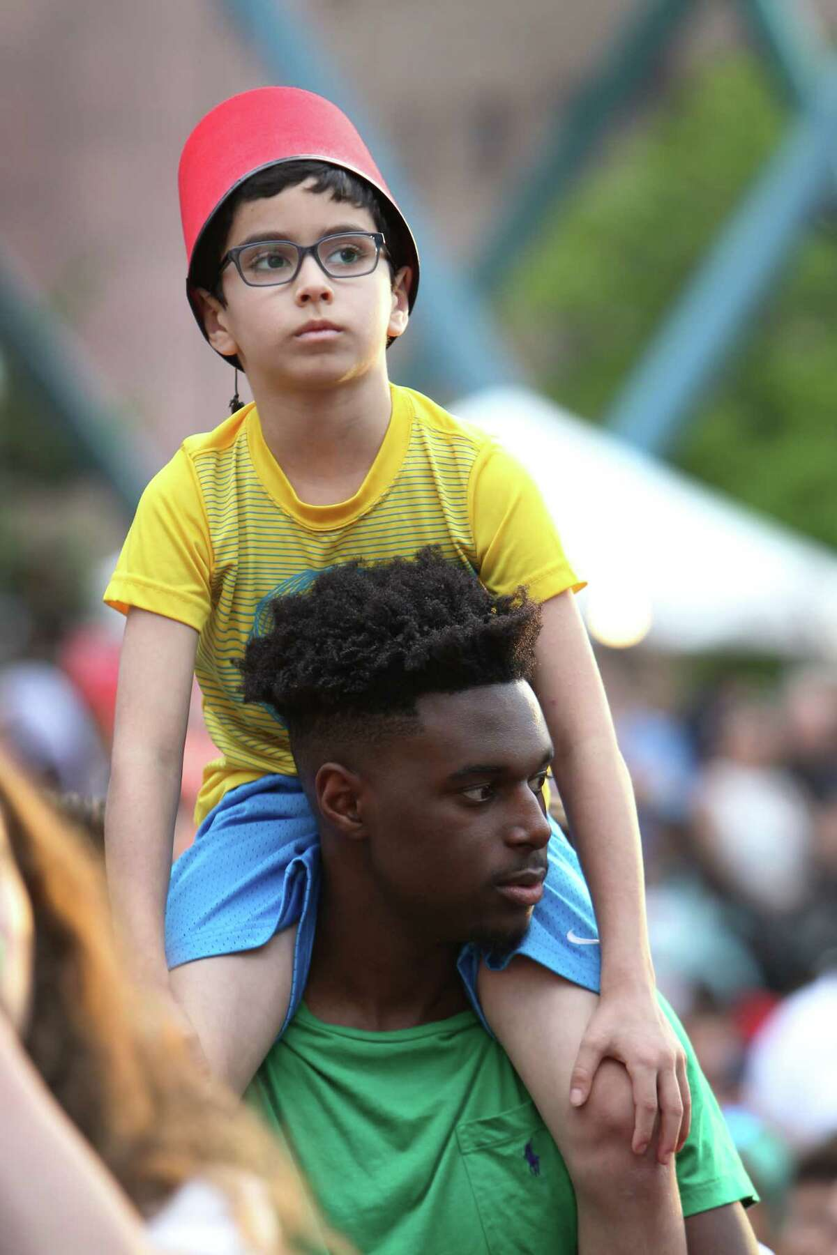 Eight-year-old Michael Koutani got a better view of the stage with the help of friend Khaalif Cooper during the Lebanese Festival held at Jones Plaza Saturday, April 1, 2017, in Houston.