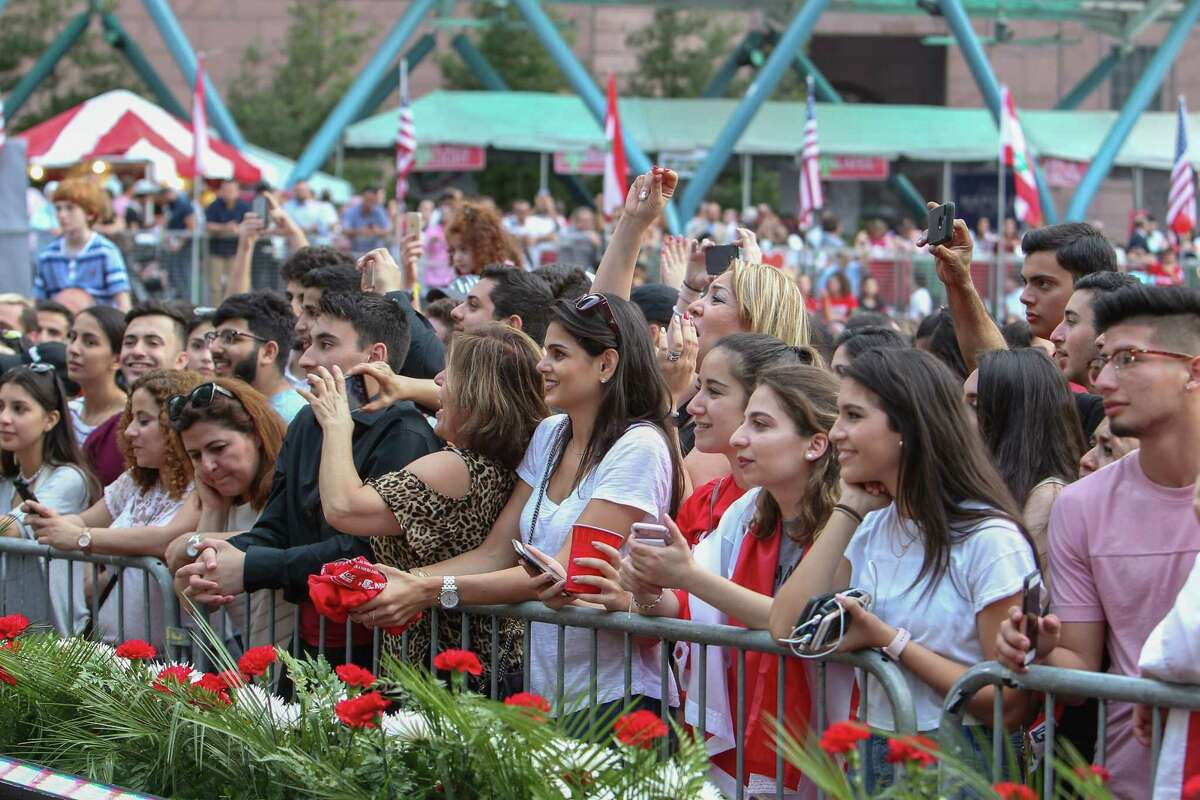 Festival attendees cheer during the Lebanese Festival held at Jones Plaza Saturday, April 1, 2017, in Houston.