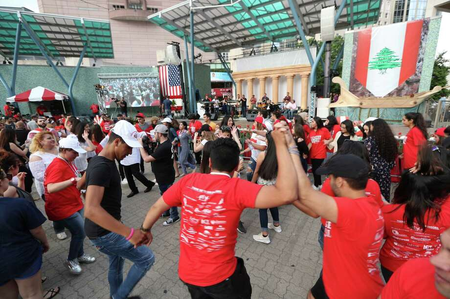 Festival attendees dance during the Lebanese Festival held at Jones Plaza Saturday, April 1, 2017, in Houston. Photo: Steve Gonzales, Houston Chronicle / © 2017 Houston Chronicle
