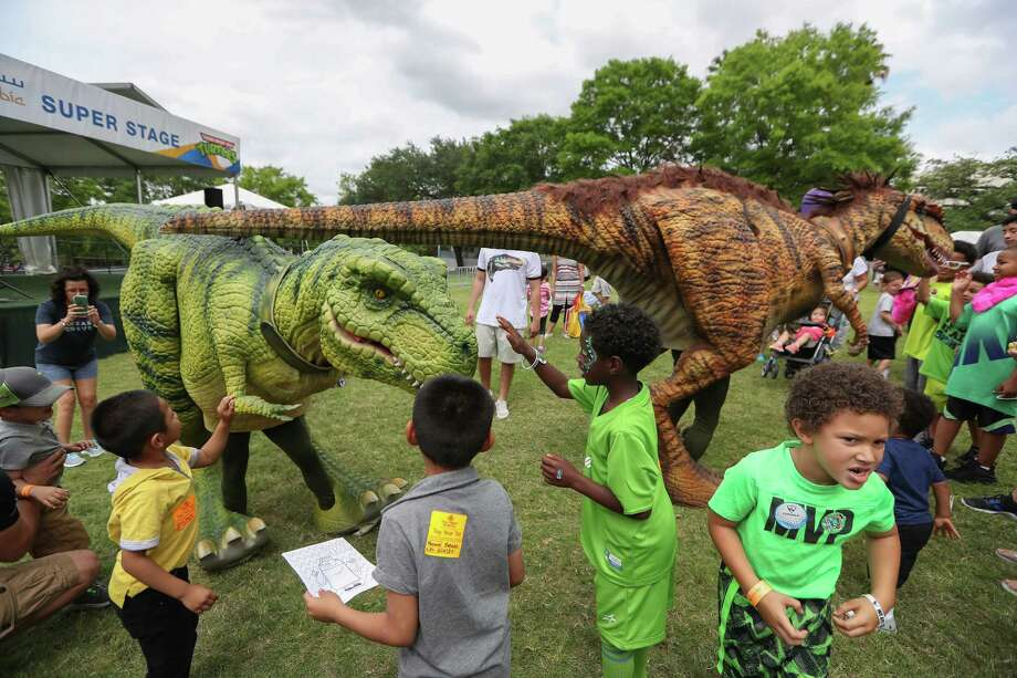 Children were amazed by the Jurassic Extreme dinosaurs at The McDonald's Houston Children's Festival Saturday, April 1, 2017, in Houston. The event is the largest children's festival in the United States. Two days of games, circus acts, rides, food, beverages, and entertainment for all ages centered in downtown Houston.   Created 28 years ago by Child Advocates as an avenue to create awareness and funding to help the neglected and abused children of Houston. Photo: Steve Gonzales, Houston Chronicle / © 2017 Houston Chronicle