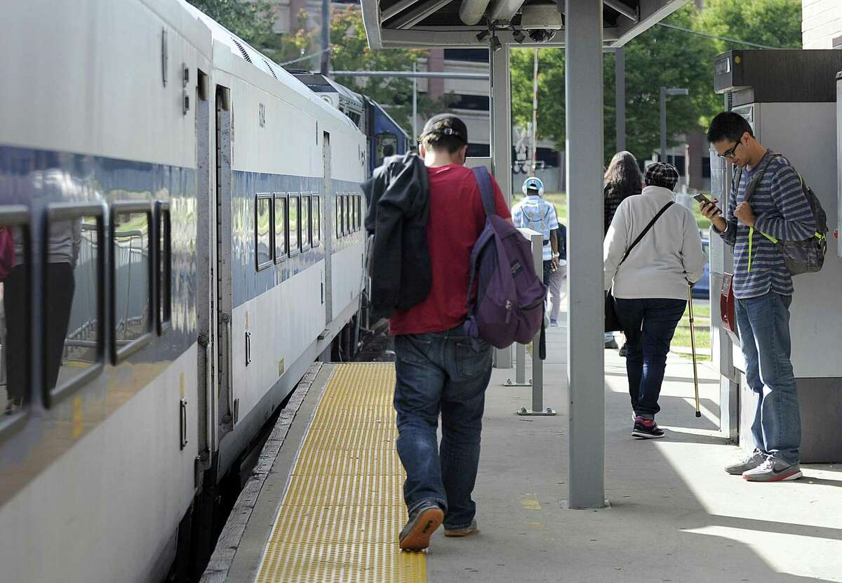 Commuters get off the train at the Danbury Train Station Tuesday afternoon, Oct. 4, 2016.