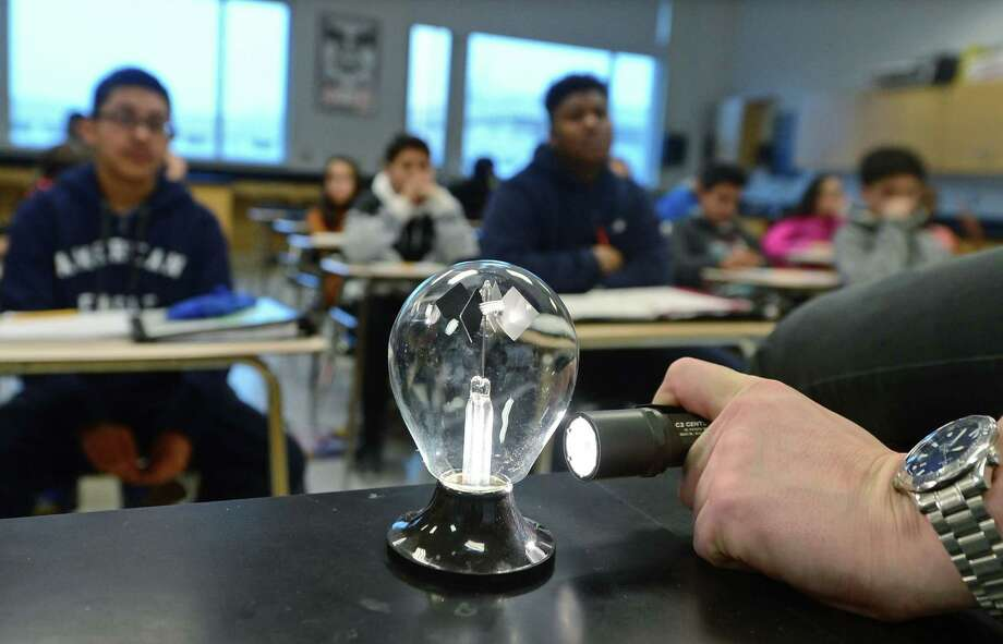 Brien McMahon High School environmental science teacher Mark Linsky, teaches his Freshman Physical Science class about energy transference using a radiometer Friday. March 31, 2017, at the school in Norwalk, Conn. A recent survey showed that 70 percent of Americans believe that climate change is occuring, but only 53 percent of those polled believe that it is anthropogenic or man-made. Photo: Erik Trautmann / Hearst Connecticut Media / Norwalk Hour