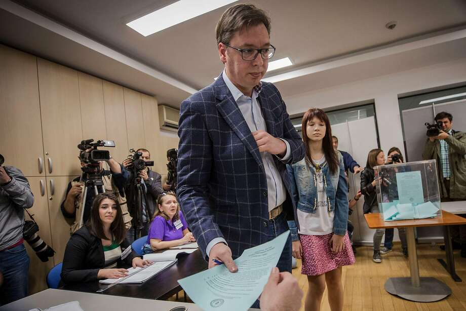 Presidential candidate and Serbian Prime Minister Aleksandar Vucic casts his vote at a polling station in Belgrade. One poll projected Vucic receiving more than 55 percent of the votes cast. Photo: OLIVER BUNIC, AFP/Getty Images