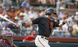 San Francisco Giants second baseman Joe Panik follows through on a swing against the Los Angeles Angels during the fifth inning of a spring training baseball game Wednesday, March 15, 2017, in Scottsdale, Ariz. The Giants defeated the Angels 7-4. (AP Photo/Ross D. Franklin)