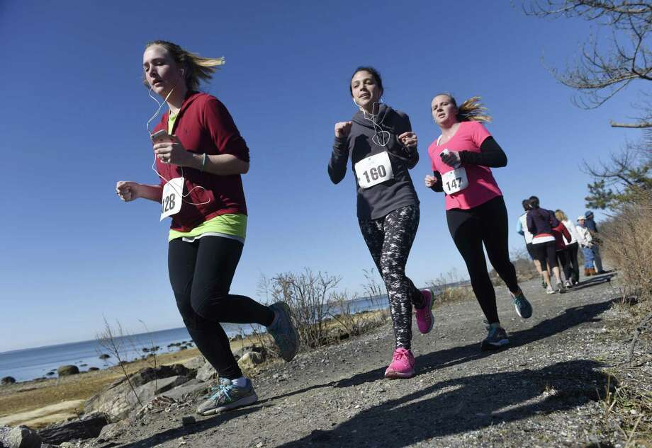 Meghan Dailey, left, Maggie Martino, center, and Andrea Kelly run in the CancerCare Walk/Run for Hope 5K at Greenwich Point Park in Old Greenwich on Sunday. Photo: Tyler Sizemore / Hearst Connecticut Media / Greenwich Time