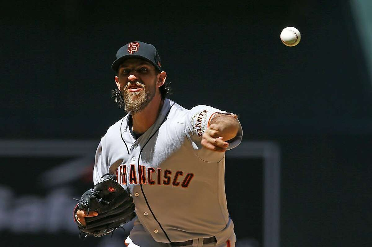 San Francisco Giants' Madison Bumgarner throws a pitch against the Arizona Diamondbacks during the first inning of an Opening Day baseball game Sunday, April 2, 2017, in Phoenix. (AP Photo/Ross D. Franklin)