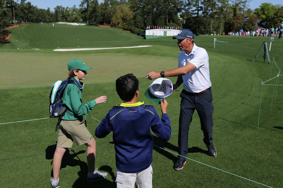 Matt Kuchar hands some young fans autographed golf balls at the ninth green during a practice round for the Masters golf tournament at Augusta National on Sunday, April 2, 2017, in Augusta, Ga. (Curtis Compton/Atlanta Journal-Constitution via AP) Photo: Curtis Compton, MBO / Atlanta Journal-Constitution