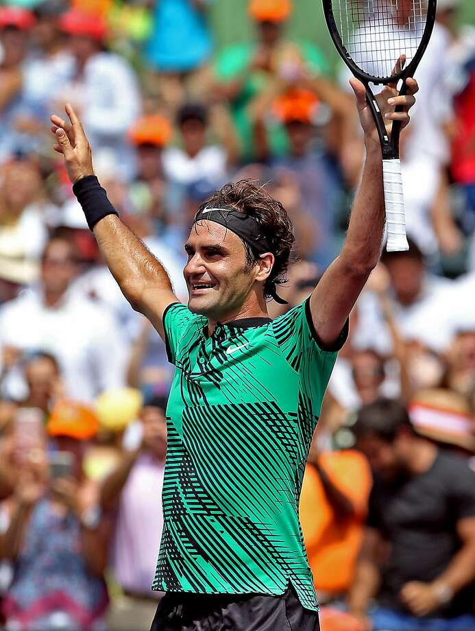 Roger Federer raises the roof after beating Rafael Nadal. Photo: Patrick Farrell, TNS
