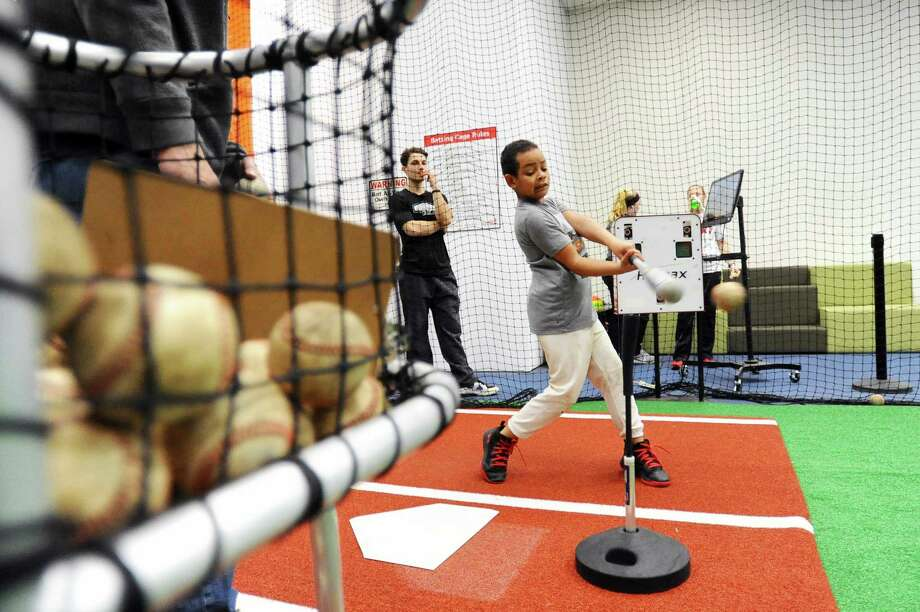 Seven-year old Jacob Donohoe, of Stamford, hits a ball of a tee during the grand opening of Bobby Valentine's Sports Academy on Largo Drive in Stamford, Conn. on Sunday, April 2, 2017. Photo: Michael Cummo / Hearst Connecticut Media / Stamford Advocate