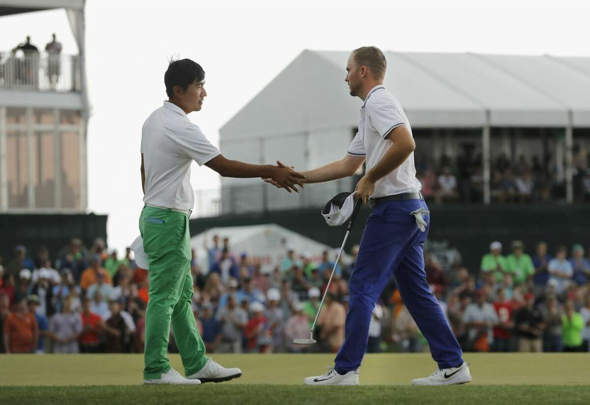 Russell Henley (right) shakes hands with Sung Kang after winning the Shell Houston Open on Sunday, April 2, 2017 at The Golf Club of Houston in Humble Texas.
