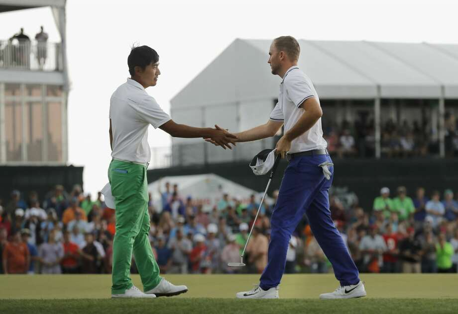 Russell Henley (right) shakes hands with Sung Kang after winning the Shell Houston Open on Sunday, April 2, 2017 at The Golf Club of Houston in Humble Texas. Photo: Tim Warner/For The Chronicle