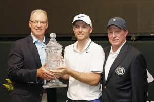 Bruce Culpepper of Shell (left) and Mike Yeager of the HGA present the trophy to Russell Henley after the final round of the Shell Houston Open on Sunday, April 2, 2017 at The Golf Club of Houston in Humble Texas.