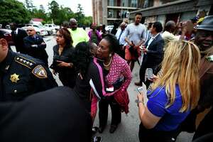 """Congresswoman Sheila Jackson Lee embraces a resident of Haverstock Hills apartment complex during the """"We Won't Quit"""" rally in north Houston on Sunday, April 2, 2017. (Annie Mulligan / Freelance)"""