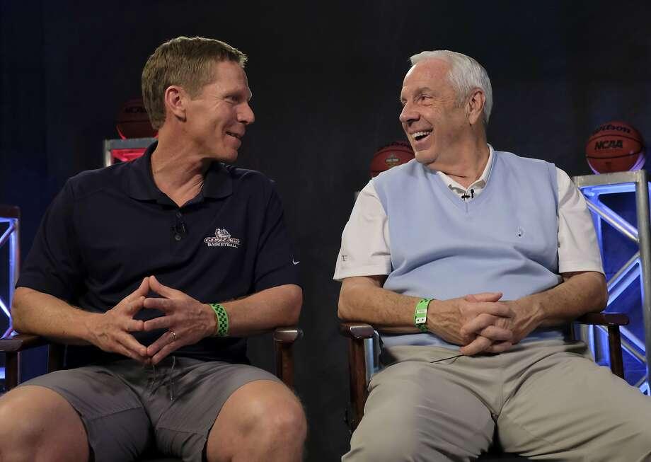 Gonzaga's Mark Few and North Carolina's Roy Williams have very different resumes. Photo: David J. Phillip, Associated Press