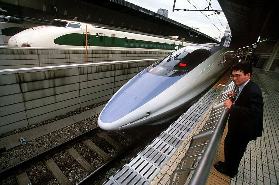 A passenger checks out Japan's sleek Nozomi Bullet train, which travels between Osaka and Tokyo. Photo: BRUCE STRONG, KRT